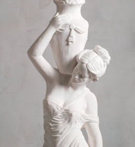 a photo of a woman statue